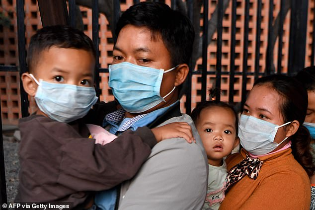 Taking precautions: Coronavirus is spreading at a rate six times faster than Sars