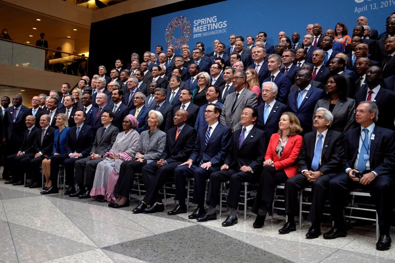 © Reuters. FILE PHOTO: Central bank governors and other global finance officials sit for a group photo at the IMF and World Bank's 2019 Annual Spring Meetings, in Washington