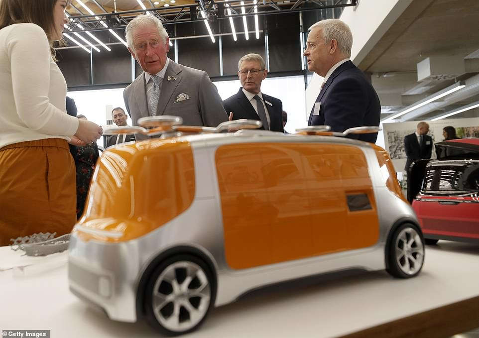 Prince of Wales looks at models of 'Project Vector' during a visit to officially open the National Automotive Innovation Centre (NAIC) and see the latest innovations in electric and autonomous vehicle technology at Warwick University on Tuesday
