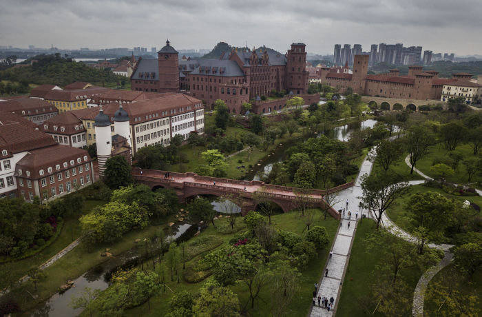 DONGGUAN, CHINA - APRIL 12: Huawei's new sprawling 'Ox Horn' Research and Development campus is seen from the air on April 12, 2019 in Dongguan, near Shenzhen, China. Huawei is Chinas most valuable technology brand, and sells more telecommunications equipment than any other company in the world, with annual revenue topping $100 billion U.S. Headquartered in the southern city of Shenzhen, considered Chinas Silicon Valley, Huawei has more than 180,000 employees worldwide, with nearly half of them engaged in research and development. In 2018, the company overtook Apple Inc. as the second largest manufacturer of smartphones in the world behind Samsung Electronics, a milestone that has made Huawei a source of national pride in China. While commercially successful and a dominant player in 5G, or fifth-generation networking technology, Huawei has faced political headwinds and allegations that its equipment includes so-called backdoors that the U.S. government perceives as a national security. U.S. authorities are also seeking the extradition of Huaweis Chief Financial Officer, Meng Wanzhou, to stand trial in the U.S. on fraud charges. Meng is currently under house arrest in Canada, though Huawei maintains the U.S. case against her is purely political. Despite the U.S. campaign against the company, Huawei is determined to lead the global charge toward adopting 5G wireless networks. It has hired experts from foreign rivals, and invested heavily in R&D to patent key technologies to boost Chinese influence. (Photo by Kevin Frayer/Getty Images)