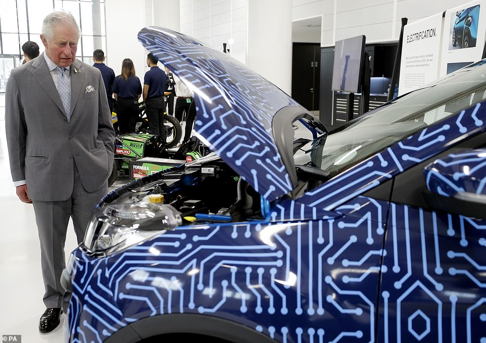 Prince Charles pictured looking under the bonnet of one of the raft of electric vehicles on display at the opening of theNational Automotive Innovation Centre in Coventry