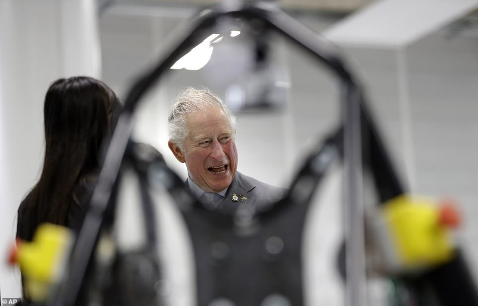 Prince Charles, seen here during the tour of the new technology centre, has already shown himself to be a fan of electric cars, having been seen driven in Jaguar's battery-powered I-Pace on a number of occasions