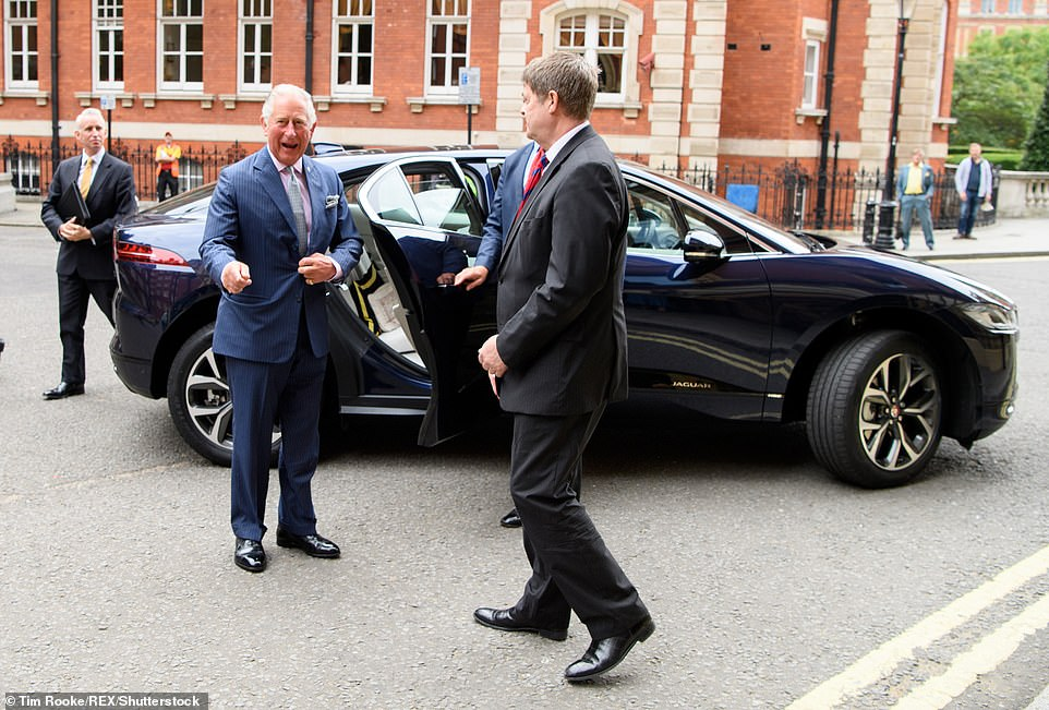 The Prince of Wales pictured exiting a £60,000 electric Jaguar I-Pace in September 2018, shortly after it hit UK showrooms