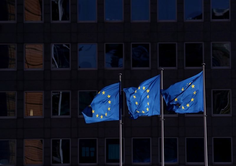 © Reuters. FILE PHOTO: European Union flags fly outside the European Commission headquarters in Brussels