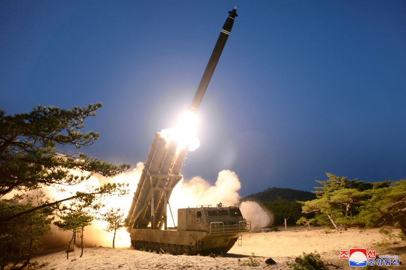 © Reuters. A view shows the testing of what local media call a super-large multiple rocket launcher in North Korea