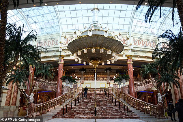 A single shopper walks through a near-deserted Trafford Centre in Manchester last week. Owner Intu revealed it has received just 29 per cent of quarterly rents due this week