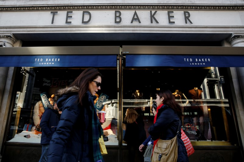 © Reuters. Shoppers walk past a Ted Baker store on Regents Street in London