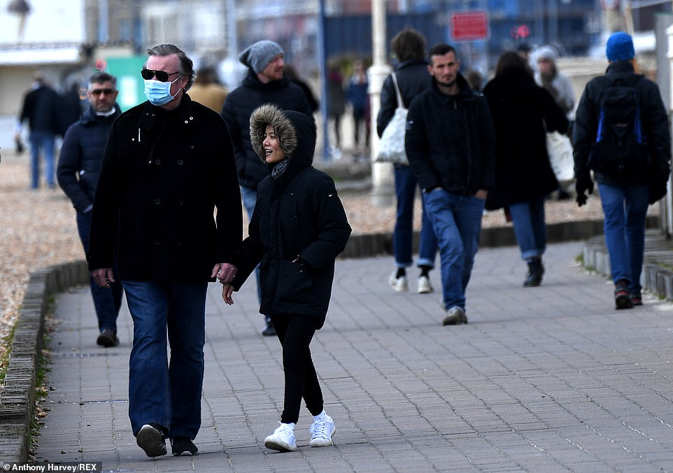 A man wearing a face mask during a walk along the promenade in Brighton, as the UK continues its coronavirus lockdown