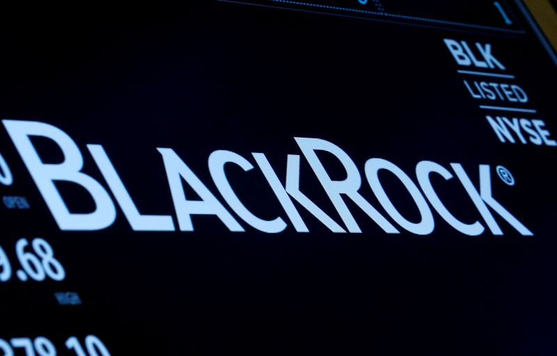 © Reuters. FILE PHOTO: The company logo and trading information for BlackRock is displayed on a screen on the floor of the NYSE