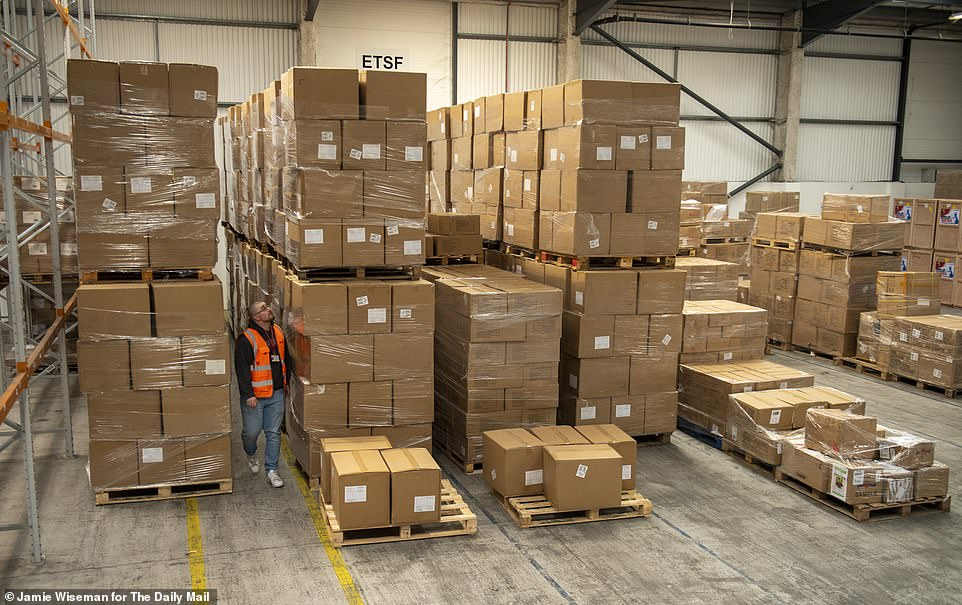 3. Mountain of boxes at depot: PPE medical equipment from China, bought for the NHS by The Daily Mail's charity Mail Force, at a warehouse in Feltham