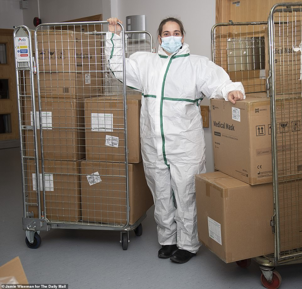 The full kit: Nurse Miss Burns clad head to foot in the new PPE after it arrived at Milton Keynes University Hospital