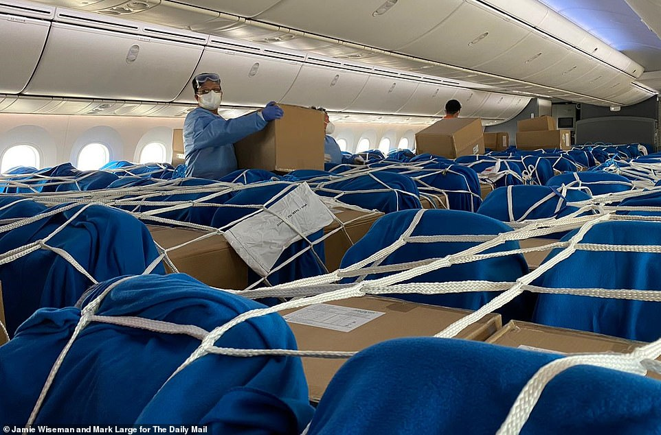 Pictured:The Daily Mail's consignment of PPE medical equipment is pictured in Shanghai as it is loaded aboard a Mail chartered plane