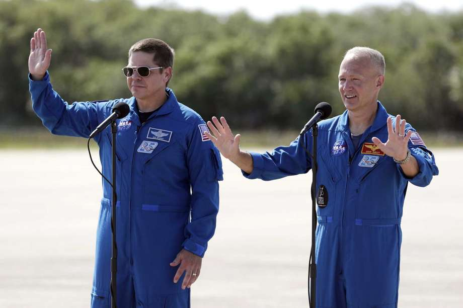 NASA astronauts Bob Behnken, left, and Doug Hurley wave as they leave a news conference after they arrived at the Kennedy Space Center in Cape Canaveral, Fla., Wednesday, May 20, 2020. The two astronauts will fly on the SpaceX Demo-2 mission to the International Space Station scheduled for launch on May 27. Photo: John Raoux, AP / Copyright 2020 The Associated Press. All rights reserved