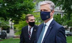 US National Security Advisor Robert O'Brien (R) is seen on the front driveway of the White House following an interview on 24 May 2020 in Washington, DC.
