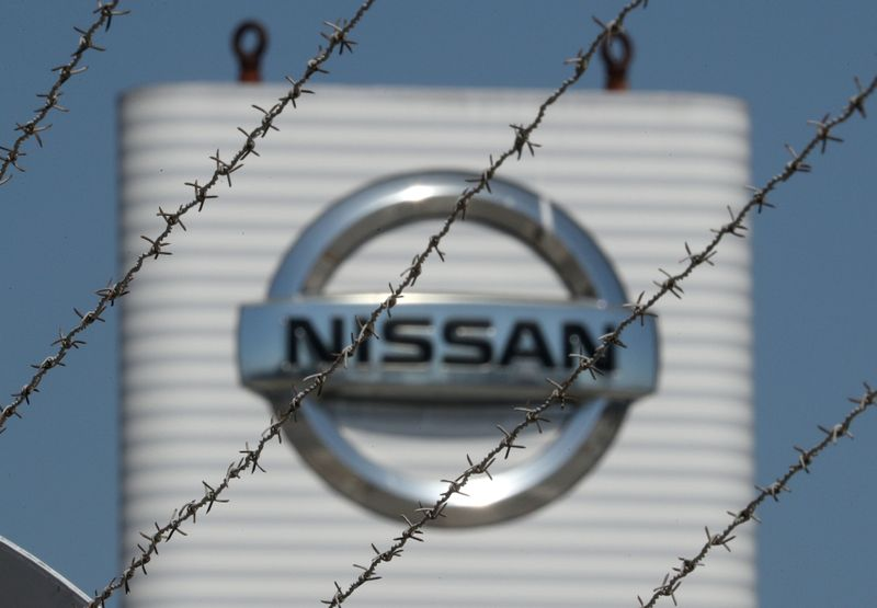 © Reuters. The logo of Nissan is seen through a fence at Nissan factory at Zona Franca during the coronavirus disease (COVID-19) outbreak in Barcelona