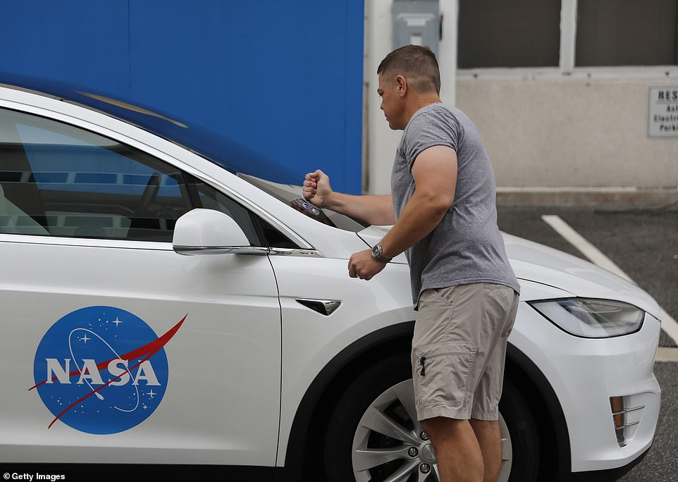 Each of the astronauts placed their space decal on the windshield of the Tesla Model X
