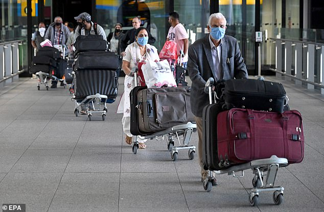 Passengers arrive at London Heathrow Airport at the weekend, where airport staff are not taking temperature checks and there are no special restrictions on entering the UK