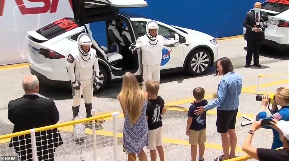 Bob Behnken and Doug Hurley say goodbye to their families before heading to the Falcon 9