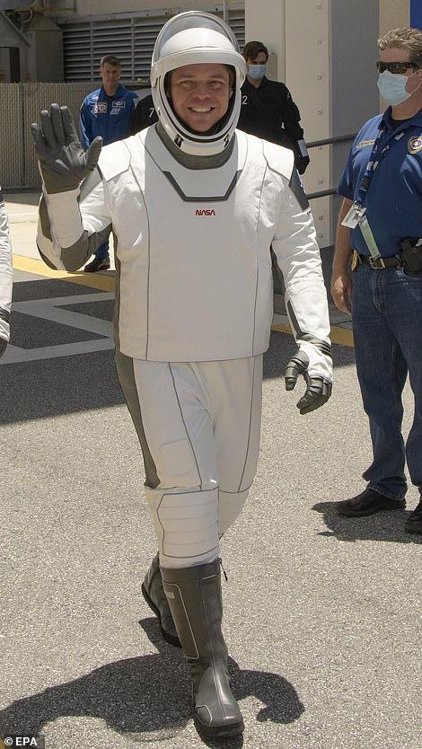 The white parts of the suit are made out of a type of Teflon, similar to that applied to the outer layers of the Apollo space suits. The black parts of the suits are made from 'Nomex' a fire retardant fabric similar to Kevlar, which is what NASA's orange 'pumpkin suits' are fashioned from.