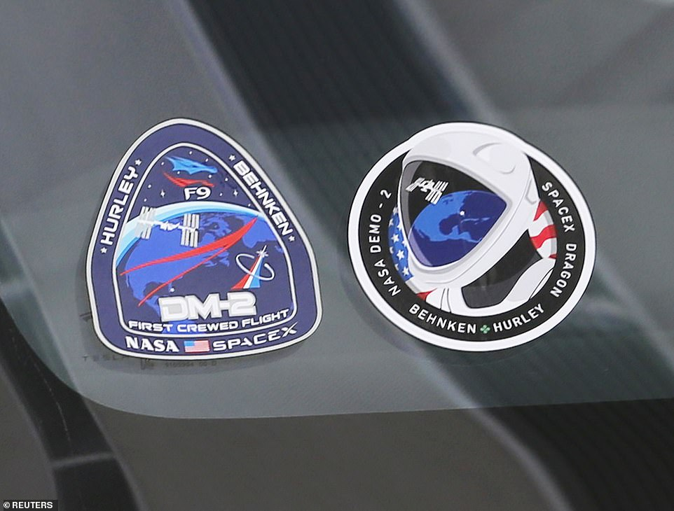 Behnken and Hurley, both veteran space travelers, arrived at the space center early Wednesday ahead of the mission. With coffees in hand, the pair shook hands and placed their own space decals on the windshield of a Tesla to commemorate the historical launch