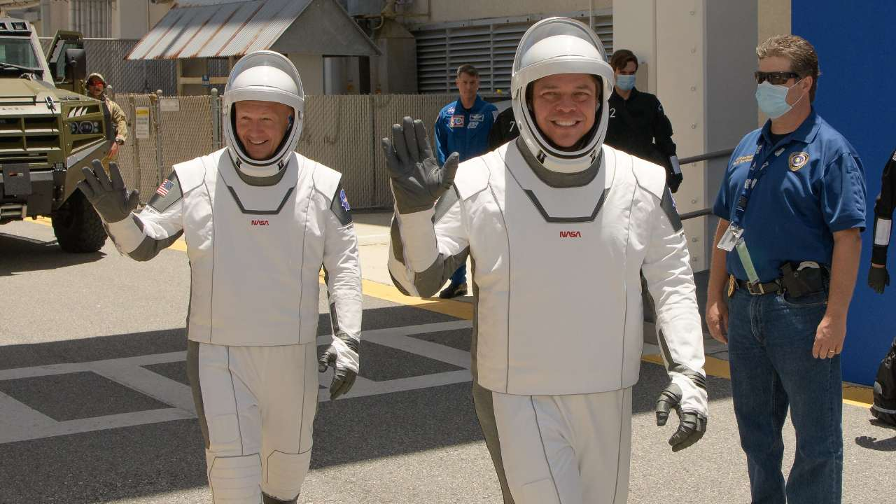 NASA astronauts Douglas Hurley, left, and Robert Behnken, wearing matchy-matchy SpaceX spacesuits, are seen as they depart the Neil A. Armstrong Operations and Checkout Building for Launch Complex 39A . Image credit:  NASA/Bill Ingalls