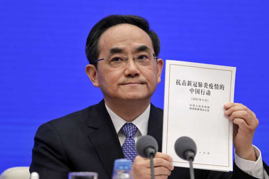 Xu Lin, Vice head of the Publicity Department of Communist Party shows a copy of the white paper on fighting COVID-19 China in action during a press conference at the State Council Information Office in Beijing, Sunday, June 7, 2020. Senior Chinese health officials defended their country's response to the new coronavirus pandemic, saying they provided information in a timely and transparent manner. Photo: Andy Wong, AP / Copyright 2020 The Associated Press. All rights reserved.