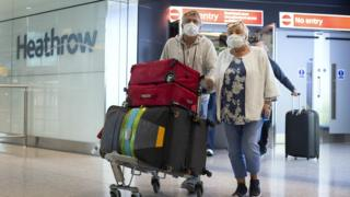Passengers from the Holland America Line ship Zaandam walk through arrivals in Terminal 2 at Heathrow Airport in London, after flying back on a repatriation flight from Florida.