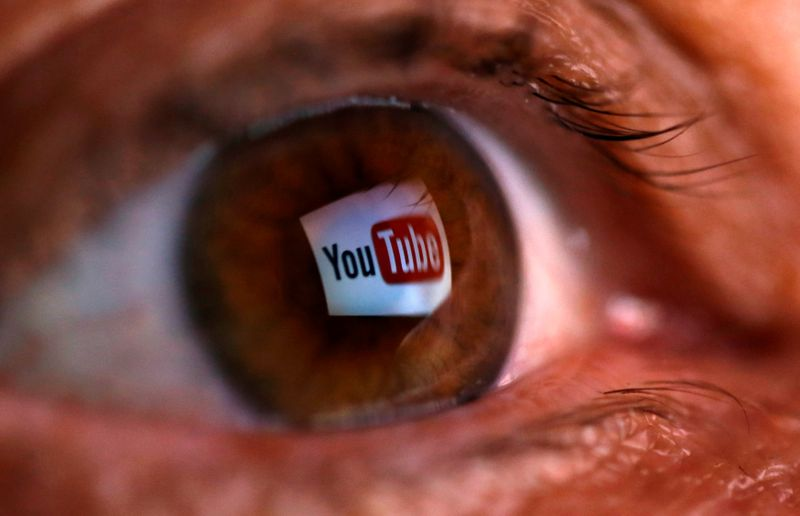 © Reuters. FILE PHOTO: A picture illustration shows a YouTube logo reflected in a person's eye, in central Bosnian town of Zenica