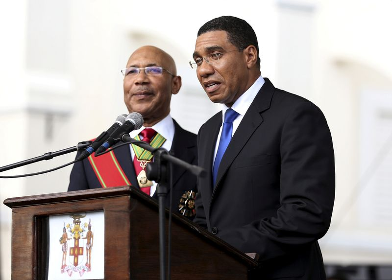 © Reuters. FILE PHOTO: Jamaica's Prime Minister Andrew Holness addresses the audience next to Jamaica's Governor-General Sir Patrick Allen during his swearing-in ceremony in Kingston