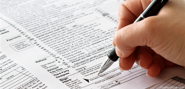 Person signing tax forms