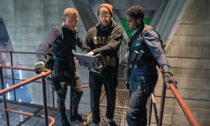 Director Cary Fukunaga with Daniel Craig (James Bond) and Lashana Lynch (Nomi) on the 007 sound stage at Pinewood Studios.