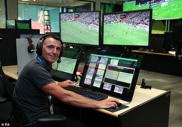 Former Premier League Referee Neil Swarbrick sits at a VAR station within the Premier League's VAR hub. Psychologists believe slow-motion replays may enhance official¿s ability to distinguish between moderate and severe offences