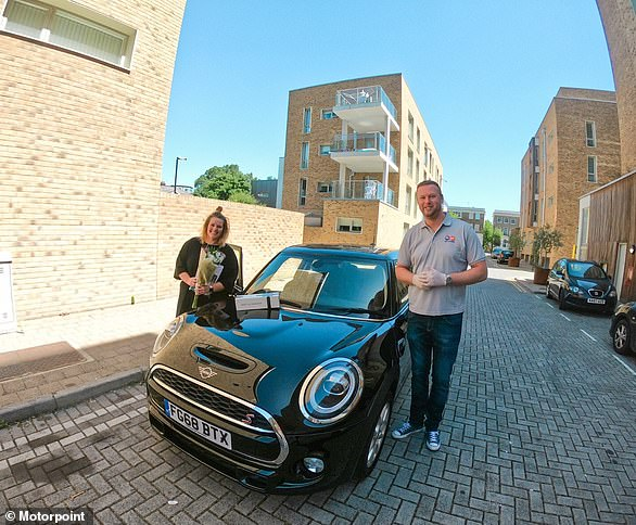 Gillian Fisher receiving her Mini Cooper S - the 1,000th car delivered by Motorpoint during lockdown