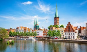 Classic view of historic skyline of hanseatic town of Lubeck with famous St. Mary's Church on a beautiful sunny day with blue sky in summer, Germany