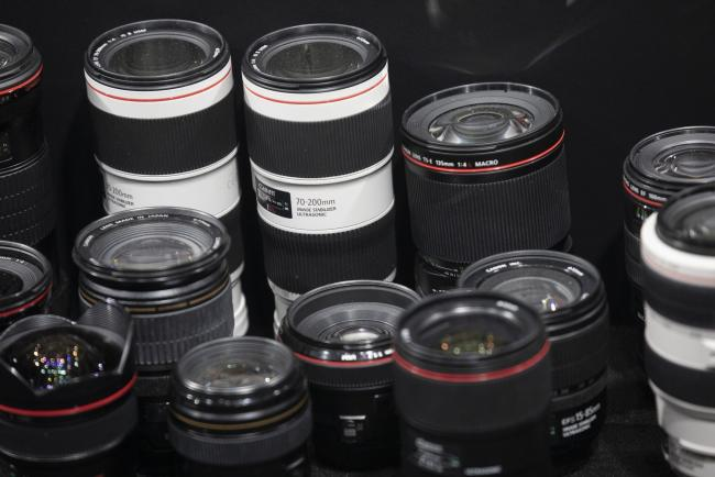 © Bloomberg. Canon Inc. lenses sit on display at the CP+ Camera and Photo Imaging Show in Yokohama, Kanagawa, Japan on Thursday Feb. 28, 2019. The annual camera show in Yokohama runs through March 3. Photographer: Keith Bedford/Bloomberg
