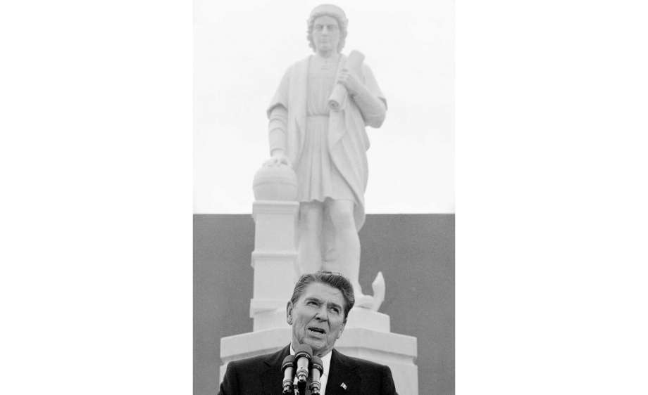 FILE - In this Monday, Oct. 9, 1984, file photo, President Ronald Reagan addresses a ceremony in Baltimore, to unveil a statue of Christopher Columbus. Baltimore protesters pulled down the statue of Christopher Columbus and threw it into the city's Inner Harbor, Saturday, July 4, 2020. Photo: Lana Harris, AP / Copyright 1984 The Associated Press. All rights reserved.