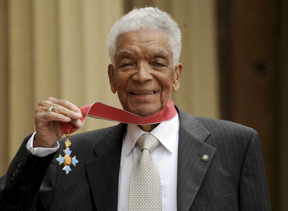 FILE - In this May 28, 2009 file photo, Earl Cameron poses for the media outside Buckingham Palace after being presented his CBE by Prince Charles, in London. Bermudian acting legend Earl Cameron has died, aged 102, it was announced Saturday, July 4, 2020. He was appointed a Commander of the Most Excellent Order of the British Empire in 2009 for his accomplishments, which included being the first black actor to star in a British feature film. (Anthony Devlin/PA via AP, file) Photo: Anthony Devlin, AP / PA