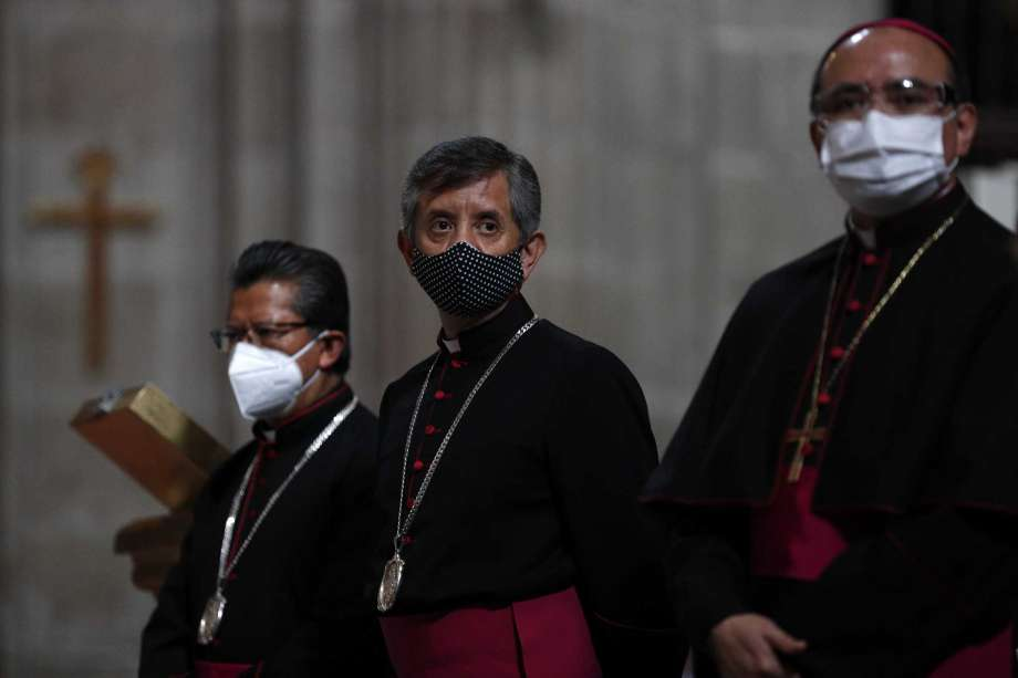 Catholic priests stand inside the Metropolitan Cathedral ahead of the first Mass open to the public amidst the ongoing coronavirus pandemic, in Mexico City, Sunday, July 26, 2020. Photo: Rebecca Blackwell, AP / Copyright 2020 The Associated Press. All rights reserved.