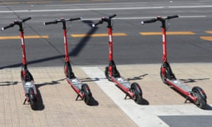 Electric rental scooters parked in a street in Chile