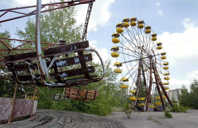 A ferris wheel and a carousel are abandoned in the amusement park of the ghost town of Prypyat, adjacent to the Chernobyl nuclear plant. (AFP)