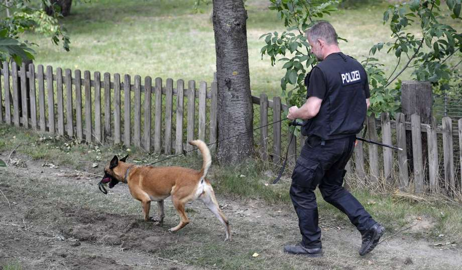 Germany police officers search with dogs an allotment garden plot in Seelze, near Hannover, Germany, Wednesday, July 29, 2020. Police have begun searching an allotment garden plot, believed to be in connection with the 2007 Portugal disappearance of missing British girl Madeleine McCann. Photo: Martin Meissner, AP / Copyright 2020 The Associated Press. All rights reserved