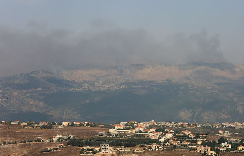 © Reuters. Smoke rises from the disputed Shebaa Farms area as seen from Marjayoun village