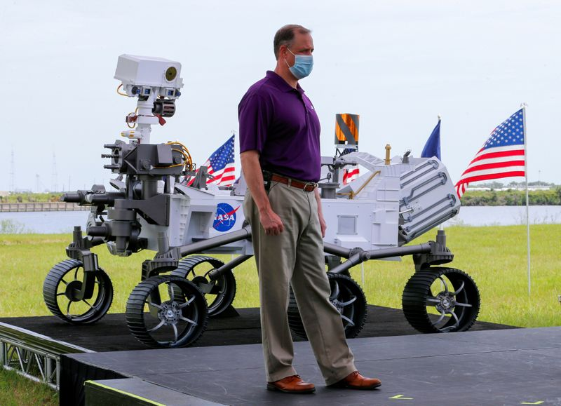 © Reuters. FILE PHOTO: NASA Administrator Jim Bridenstine stands next to a replica of the Mars 2020 Perseverance Rover during a press conference, at the Kennedy Space Center in Cape Canaveral