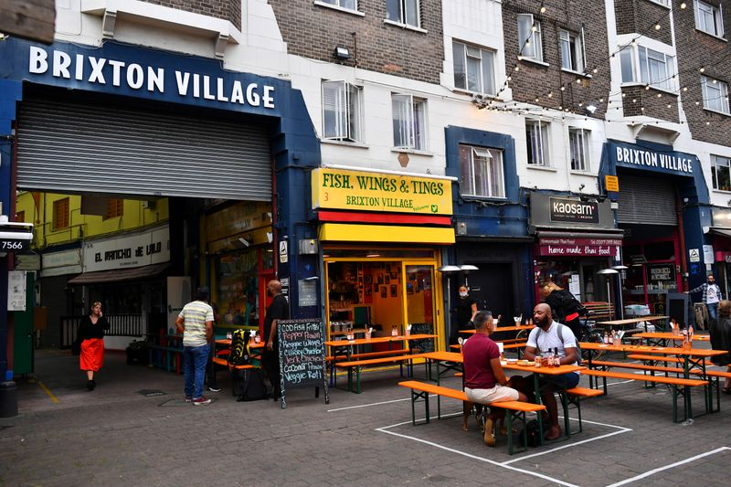 © Reuters. Empty tables are seen during a quiet night at Brixton Village in London