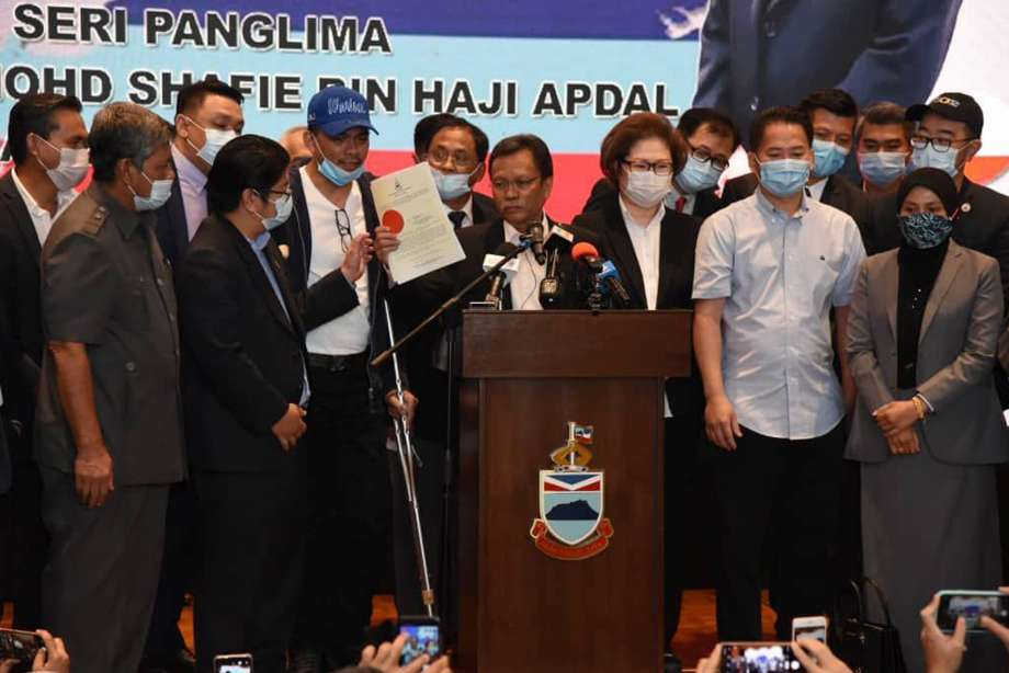 Sabah Chief Minister Shafie Apdal, centre, in Kota Kinabalu, Sabah, Malaysia Thursday, July 30, 2020. Shafie dissolved the state parliament to pave the way for polls after a ruling party politician claimed he had majority support of lawmakers to form a new government. Photo: AP / Copyright 2020 The Associated Press. All rights reserved.