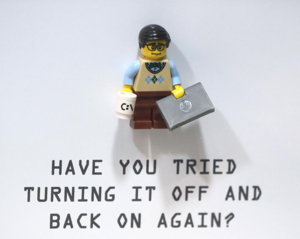 A Lego-style depiction of an IT Crowd character with ″have you tried turning it off and on again″ quoted below.