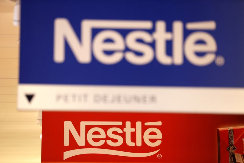 © Reuters. FILE PHOTO: Nestle logos are pictured in the supermarket of Nestle headquarters in Vevey