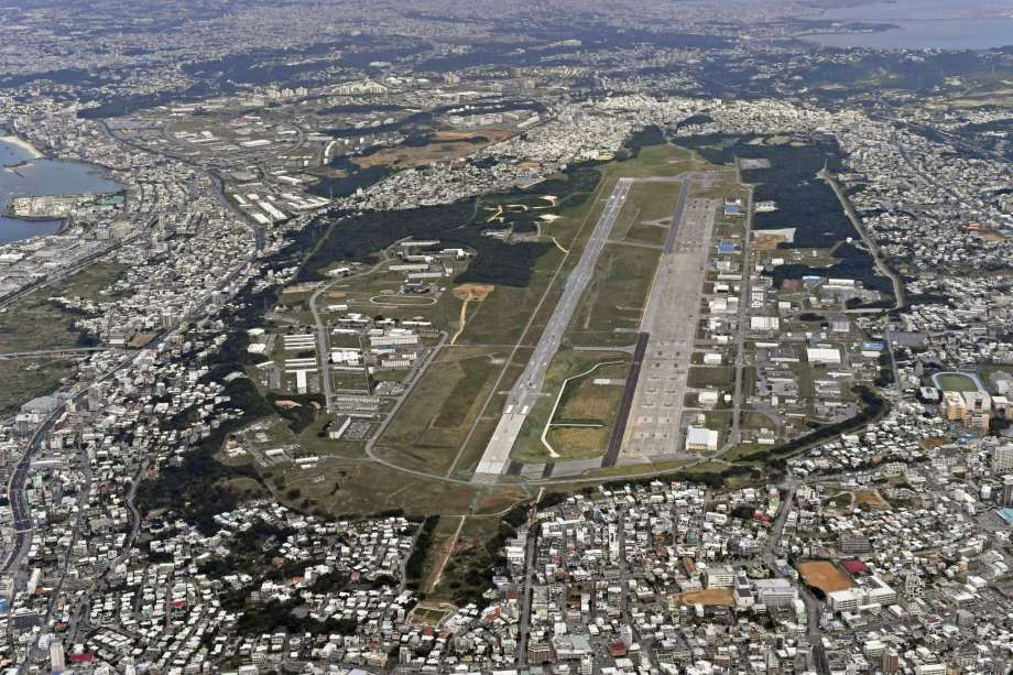 FILE - This Jan. 27, 2018, aerial file photo shows U.S. Marine Air Station Futenma in Ginowan, Okinawa, southern Japan. Okinawan officials said Saturday, July 11, 2020 that dozens of U.S. Marines have been confirmed to have infected with the coronavirus at two bases, Futenma and Camp Hansen, on the southern Japanese island in what is feared to be a massive outbreak, and demanded adequate explanation from the U.S. military officials. (Kyodo News via AP, File) Photo: AP / Kyodo News