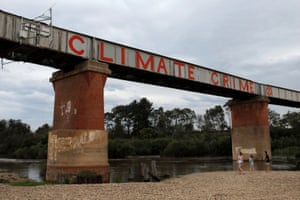 A climate protest painted on a bridge over the Avon River in the Gippsland town of Stratford in Victoria
