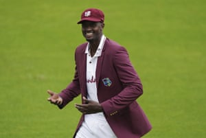 West Indies' captain Jason Holder smiles as he leaves the ground after winning the toss.